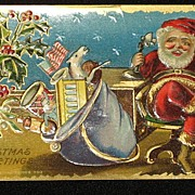 Antique Embossed Postcard-Santa Behind Desk & On the Phone with Bag of Toys-Merry Christmas ..