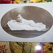 Little Baby Photograph Nude wearing a necklace H. Crampon