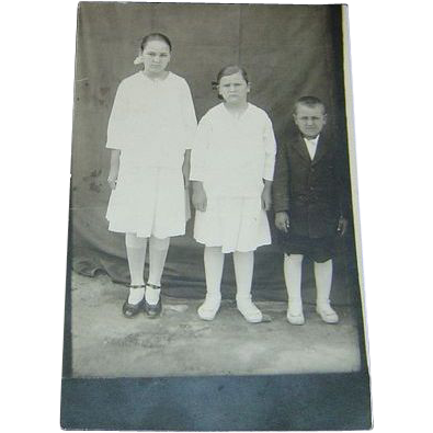 Vintage Postcard of Three Happy Children