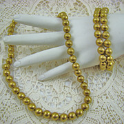 Bergere Ribbed Gold Tone Bead Necklace and Bracelet Set