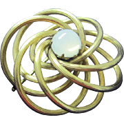 Vintage gold tone metal looped with moonstone pin