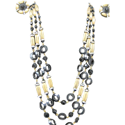 Vintage Hobe triple strand necklace and matching clip earrings