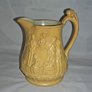 Rare & Important Molded English Yellow Glaze Stoneware Jug Depicting Scenes from Uncle Tom's C