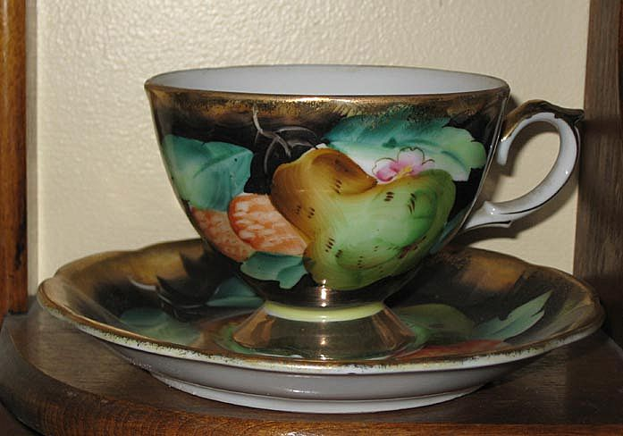Tea Cup, ftd & Saucer  Black and Gold, Pear & Berries Decorated