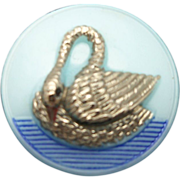 Two glass buttons with raised swans in water