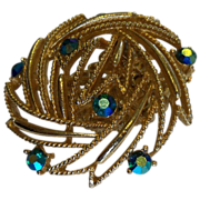 Lisner Circular Gold Metal Brooch  with Green Aurora Borealis Stones
