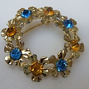 Circular Gold Metal with Colored Rhinestones Brooch
