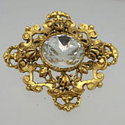 Gold Metal Brooch with Ornate Design and Large Center Rhinestone