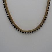 Gold Metal Necklace  highlighted with Black Rhinestones