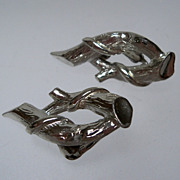 Coro marked silver metal swirl earrings