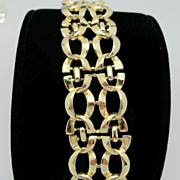 Coro marked wide gold metal bracelet