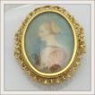 Oval Portrait in Filigree Frame Brooch/Pendant