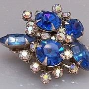 Asymmetrical blue and clear rhinestone brooch
