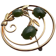 Gold Metal Circular Brooch with Jade Color Glass Stones