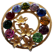 Dramatic Gold Metal Circle Pin with Rhinestones