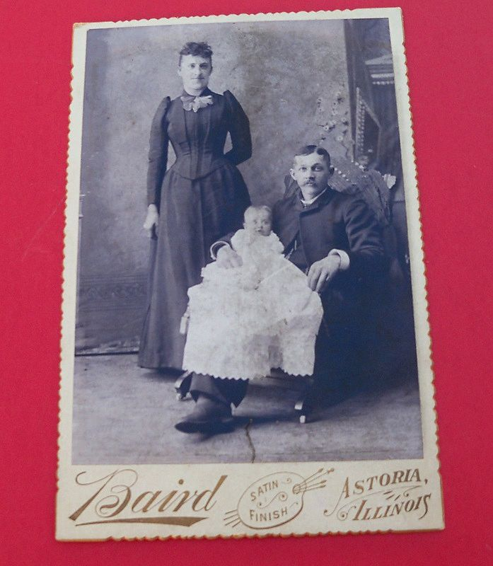 Studio Photo of a Young Couple with Baby