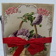Postcard Birthday Card tied with a red ribbon