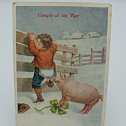 "Postcard ""Little Boy Caught by a Pig"""