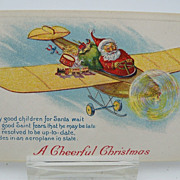 Postcard Santa Delivering Toys in an Airplane
