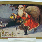 Postcard Santa Walking in  Snow Carrying a bag of Toys