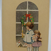 Christmas Postcard with two children and a teddy bear