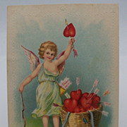 Cupid with a basket of valentines Postcard