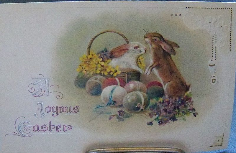 A Joyous Easter Card with Rabbits and Eggs