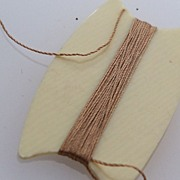 Ivory colored celluloid thread winder
