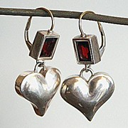 Contemporary sterling silver heart and garnet earrings.