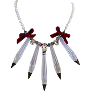 Vintage crystal pendant on contemporary pearl necklace. High end necklace design.
