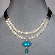 Romantic contemporary jewelry. Upscale pearls and turquoise necklace.