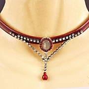 In vogue jewelry design. Contemporary necklace of leather silver and rhinestones.