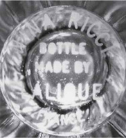 Acid Etched Forgeries of Lalique Marks