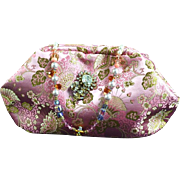 Vintage pink brocade evening bag with a Miriam Haskell pin as the clasp and crystal ...