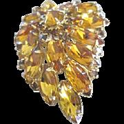 All amber colored rhinestones in a  leaf shape pin