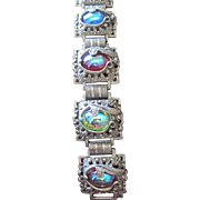 Dragon's Eye pewter color link bracelet with multi colored glass AB finish jewels