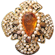 Vintage Schreiner of New York simulated pearl and rhinestone pin in a heraldic style