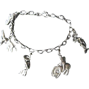 Heavy Fenwick and Sailors sterling charm bracelet with five charms circa 1950's