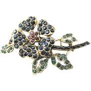 Swoboda Floral pin by Nate Waxman set with rubies, sapphires and emeralds in a gold plated bas
