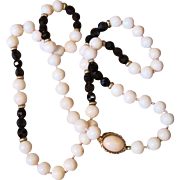 """Estate 30"""" long strand of angel skin coral and garnet beads with 18k gold clasp and space"""