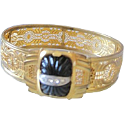Edwardian gold gilt filagree cuff bracelet with black glass center set with a line of ...