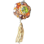 Costume jewelry Pin in Fall colors demantoid green amber and golden with a dangle chain ...