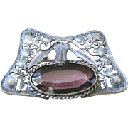 Exceptional Victorian pewter sash pin surrounding a large purple glass jewel embellished with