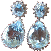Exceptional pair of 18kwg earrings over 7.50 carats of aquamarines and 84 diamonds weighing 1.