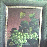 Framed still life painting of lush grapes