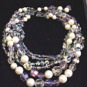 Signed DeMario six strands of vitreal crystal bead necklace