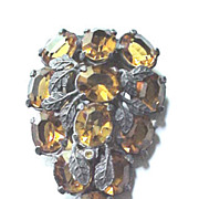 Nice Art Deco dress clip with large amber unfoiled rhinestones