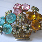 Jeweled flower basket pin with multi colored rhinestones