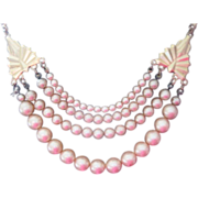 Nice Art Deco simulated pearl necklace suspended from gold filled leaves