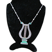 14k YG Emerald and Enamel lyre pendant on 14kWG Diamond chain